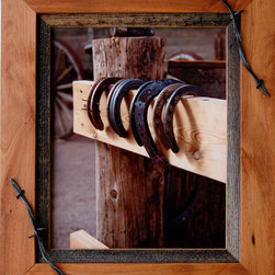 MyBarnwoodFrames - Western Frames-11x14 Wood Frame with Barbed Wire Sagebrush Series  Siz - Western  Frames-11x14  Wood  Frame  with  Barbed  Wire  -  Sagebrush  Series          ---  Rustic  Frames  handcrafted  from  natural  hardwood  and  accented  with  a  1/2  inch  reclaimed  barnwood  inset  and  a  barbed  wire  overlay.  This  rustic  wood  frame  is  stained  light  walnut  color  and  is  perfect  for  framing  photos  and  art.  Each  11x14  picture  frame  will  accommodate  one  11x14  inch  photo  or  print  and  can  be  hung  horizontally  or  vertically.  The  frame  includes  glass  and  hanging  hardware.  Cleans  with  a  soft  cloth.  Backing  is  included  and  is  secured  with  flexible  push  points  so  inserting  your  own  photos  is  simple.  We  craft  each  of  our  country  frames  to  withstand  generations  of  use.  Corners  are  glued  and  secured  with  a  screw  so  they  won't  separate.  Each  of  these  country  frames  makes  a  great  gift.  A  rustic  frame  perfect  for  multiple  decor  styles.                     Product  Specifications:                   Finished  Dimensions:  14.5H  x  17.5W  x  .75D              Includes  glass  and  hanging  hardware              Can  be  hung  horizontally  or  vertically                               Please  Note:   Your  purchase  includes  a  frame,  glass,  and  hardware  for  hanging.   Photos  are  NOT  included.