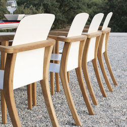 Zidiz - A thin aluminum sheet, shaped into a minimalistic seat to be hung into a warm organically shaped teak frame, doesn't sound like a perfect marriage. But ZIDIZ proves that it does look like one!