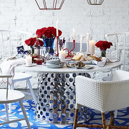 "Como 60"" Round Marble Top Dining Table - Paola Navone's unique and unexpected furnishings are simple, elegant and immediately familiar, with a livable look that blends with any style. Bold perforated circles pattern aluminum base topped with gorgeous Italian Carrara marble in an eclectic mix of handworked metal and natural stone. Crafted for us exclusively in Mumbai, each round base is crafted of a single sheet of aluminum that is die-cut, welded and polished to a gleaming mirror finish. Solid 8mm marble top displays the unique markings and color variations of pure, unfinished marble and is built around an aluminum honeycomb interior to provide lightweight support and minimize the chances of breakage.  A clean, modern pedestal table, generously proportioned for gathering friends and family."