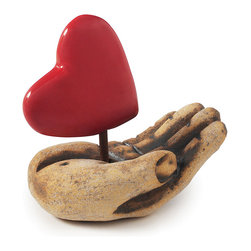 Contemporary Stoneware, Glaze  Handmade Heart in Hand - Carved by hand from stoneware, this sculpture represents the willingness to give and receive love, as well as the need to protect it. Lovingly made by hand, each piece bears one-of-a-kind details, much like the loved ones in our own lives. The intricate folds and lines in the hand and fingers are added after the clay is firm to give the hand a distinctive and realistic feel. Since each sculpture is individually carved, no two pieces are alike. Handmade in Kansas City.