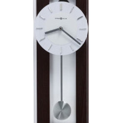 "Grandin Road - Emmett Wall Clock - Black coffee finish resembles Wenge wood. 3/16"" thick plate glass cover suspended on polished chrome finished buttons. White dial with chrome finished bar style hour markers. Silver finished hour and minute hands. Swinging pendulum. If you like to think outside of the box, the Emmett Wall Clock from Howard Miller helps you do so in a memorable way. This distinctive timepiece completes any design scheme, with multiple layers of art, wood, and metal enhancing its presentation.  .  .  .  .  . Battery-operated quartz movement . Requires one AA battery (not included) ."