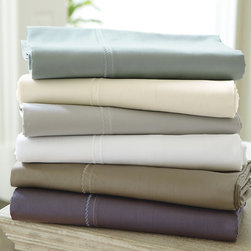 Ballard Designs - Sateen Sheet Set - Choose from six Tuscan-inspired colors. Coordinates with our Casa Florentina Sateen Duvet Sets. Includes drawstring storage bag. Flat Sheets & Pillow Cases can be monogrammed. Made in Italy from luxuriously soft 100% cotton, our Casa Florentina Cotton Sateen Sheet Set has a silky hand and low-luster sateen finish. Each piece is bordered in refined Florentine stitching for an elegantly tailored attitude. The understated, neutral colors were carefully selected to blend with the hand finishes of our Casa Florentina furniture to create a sophisticated European look. The more you wash them and sleep in them, the softer these sumptuous linens become. King Sets include: 1 flat, 1 fitted and 2 king pillow cases; Twin, Full & Queen Sets each include: 1 flat, 1 fitted and 2 standard pillow cases.Cotton Sateen Sheet Set features:. . . .