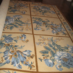 English country house in Manhasset - Took floral motif from fabric used in window treatment over window seat and created custom rug