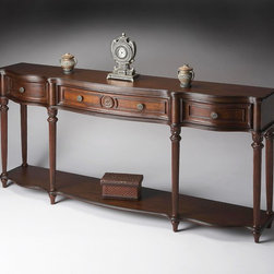 Butler - Butler Plantation Cherry Console Table 3028024 - This gorgeous console exudes grandeur. Crafted from select solid woods  wood products and choice veneers  it features a shapely top  lower shelf and drawer fronts all done in cherry veneers. The legs have a fluted design with hand carved acanthus leaf detail. Three drawers with resin accents and antique brass finished hardware.