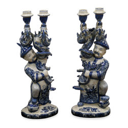 "China Furniture and Arts - Porcelain Candle Holders - 18th century European merchants traveled to China for its beautiful porcelain ware. Paying tribute to an original design, a skilled porcelain artist has recreated these pair of ""imperial guard dragon candle holders"" in the soft blue and white glazed porcelain. Completely hand crafted in China."