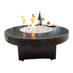 "Oriflamme Fire Tables - Gas Fire Pit - Oriflamme 42"" Hammered Copper Fire Table - The award winning Hammered Copper fire pit table by Oriflamme Fire Tables is an absolutely stunning table made from 18 gauge sheets of real copper!  These impressive hand-hammered copper tables bring unexpected clean lines to age-old elements and a beautifully functional focal point to your outdoor living space. The vintage-fired finish gives the tabletop fire pit a true rustic richness, while the stainless-steel burner generates up to 65,000 BTUs – more than double the warmth of many propane-powered fire tables.Copper has been used in architecture, jewelry, and many other beautiful things, and now you can get it in your fire table! Make a statement of your patio.The table comes with a 20 lb. propane tank that is concealed within the base for an unmatched burn time of 22 hours along with a beautiful heavy metal lid and a stunning mix of premier fire glass.  The Oriflamme Fire Tables are specially designed to be the perfect outdoor fire table at a coffee table height of 19"", you won't remember how you functioned with out one!"
