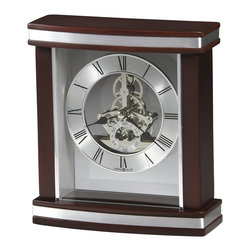 Howard Miller - Templeton Table Top Clock w Rosewood Finish a - Look inside this contemporary, carriage-style clock right through to its internal mechanism. The mesmerizing workings are finished in polished silver. On the outside, the dial is surrounded by Rosewood-finished trim and silver accents. Features black Roman numerals. This contemporary satin Rosewood finished carriage clock with curved front and silver accents features a glass crystal that reveals the intricate, polished silver finished skeleton movement. The dial includes a circular brushed silver-finished numeral ring with black Roman numerals, spade hands, and separate seconds track with Arabic numerals. A felt bottom protects your desk or tabletop. Quartz movement includes the battery. 6 3/4 in. W x 2 1/2 in D x 7 1/2 in. H