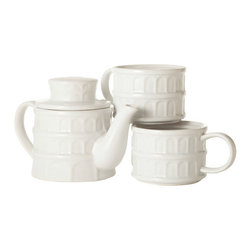 Contemporary White Ceramic Teapot and Mug - Teatime reaches precarious new heights with this Teapot Mug Tower. It keeps all your sipping essentials close at-hand in one stackable (albeit slightly askew) design. When not in use, this set is a countertop tribute to an infamous piece of architecture.