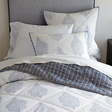 New Hand-Blocked Medallion Quilt - Pop goes the paisley. Certified by the Indian nonprofit Craftmark as authentically hand block-printed and hand-quilted, this lightweight cotton voile bedding is made by the master artisans of north India's Rajasthan. A classic paisley design pops in shades of blue on white cotton voile on the front, while a geometric, mosaic-like pattern that's more blue than white covers the back. It works beautifully as a standalone in warmer months—and plays well with finely textured patterns and solids alike—but also makes a great extra layer of coziness in winter.