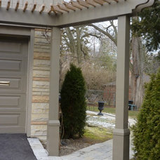 Contemporary Landscape by Benchmark Building Services Inc.