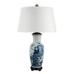 Oriental Danny - Blue and white porcelain lamp - Blue and white porcelain lamp with dragon design. Lamp shade is made of hardback linen. Very classy lamp in any room. Wattage: 100 watt, 3-way switches, UL listed.
