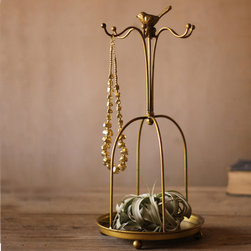 Metal Jewelry Stand - Leave it to the warblers to look after your oft doffed earring and necklaces on this 17 inch high antiqued gold jewelry stand. So simple and elegant at the same time.