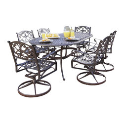 Home Styles - Home Styles Biscayne 7 Piece Dining Set in Bronze Rust - Home Styles - Patio Dining Sets - 5555335 - Biscayne 7PC Dining Set includes Oval table and Six Swivel Arm Chairs. Home Styles cast aluminum outdoor dining collection gives you the beauty of ornately designed pieces without the high cost. Constructed of cast aluminum in a UV resistant powder coated hand applied Deep Rust bronze Antique finish. The Oval Dining Table features a Deep Rust bronze Antique finish with a top that is designed specifically to prevent damage caused from pooling by allowing water to pass through freely.  Adjustable nylon glides prevent damage to surfaces caused by movement and provide stability on uneven surfaces.
