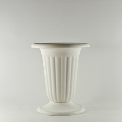 White Plastic Pedestal Urn - A pair of inexpensive plastic urns decorated with poinsettias will dress up a front doorway. No one will even know they are plastic.