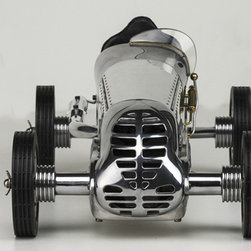 Thos. Baker - bb korn car - For a few short years before and after WW ll, the ear splitting shriek of hand-built model race cars known as spin-dizzies or tether cars could be heard across America and from the beginning they were always much more than toys. Best known are the models from the BB Korn Manufacturing Company, introduced in 1938 and featured hand-cast alloy chassis, a louvered aluminum body and ball bearing axles. Powered by model airplane engines these models reached speeds over 150 miles per hour. These replicas are true to many of the original details and represent some of the finest in American craftsmanship.�