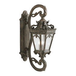 Kichler 4-Light Outdoor Fixture - Londonderry Exterior - Four Light Outdoor Fixture. With its heavy textures, dark tones, and fine attention to detail, the Tournai collection stands out from other outdoor fixtures. Each piece is hand-made from cast aluminum, offering quality construction that is sure to withstand even the harshest of weather conditions. Our exclusive Londonderry finish and clear seedy glass panels give the piece its unique, aged look. If you want the classic profile of the wall lantern, this Tournai outdoor lamp deserves your attention. Its 4-light design uses 60-watt bulbs to deliver lighting ideal for everyday use. Although it measures 38 high, the fixture is provided with variable height mounting hardware and is UL listed for wet locations.