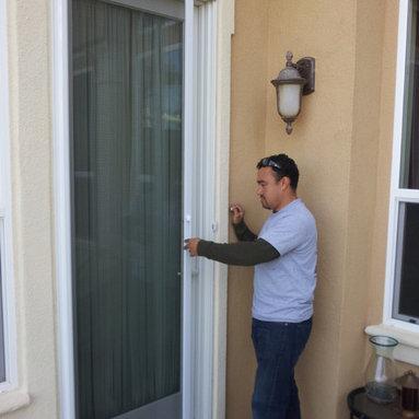 Mirage Retractable screen door - Mirage Retractable screen unit installation Brentwood area polar white. patio door.