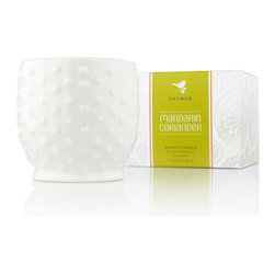 Mandarin Coriander Hobnail Candle - A modish reinterpretation of vintage hobnail containers makes the white ceramic cup of the Mandarin Coriander Hobnail Candle a perfect addition to the bedroom shelf or kitchen counter - and the aroma of this high-quality poured paraffin candle is an energizing, welcoming blend of juicy ripe oranges and spicy, complex herbs, made ideal for either room by its bright, happy potency.