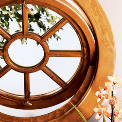 Marvin® Windows - Marvin® Signature Services special shape window - round pivot window with simulated divided lite and brass hardware.