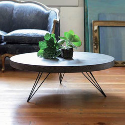 Ray Legged Coffee Table - This table radiates up from your flooring to a rounded surface with room to entertain. The matte black veneer top and wiry, angular legs make a great contrast that blends mid-century and industrial inspirations to suit a stylish, modern home.