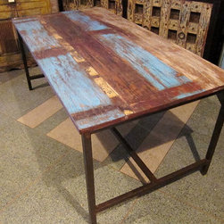 Blue Rustic Modern Dining Table by Hammer and Hand Imports - This table was made from reclaimed wood signs and discarded iron. I love the patina on the iron and tabletop. I can't help but think that it'd be great in a home with destructive children.
