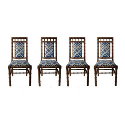 "Pre-owned Hollywood Regency Bamboo Dining Chairs - Set of 4 - High style chairs with a Hollywood Regency feel. This set of 4 dining chairs features faux bamboo frames and charming blue and white bamboo patterned upholstery. Although they've got great ""bones"", this set could use some love, and would look stellar refurbished."