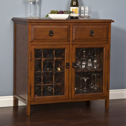 Belham Living - Belham Living Genova Wine Rack and Server - Dark Oak Multicolor - HX12114-1 - Shop for Wine Bottle Holders and Racks from Hayneedle.com! Wine is often a staple of joyous celebration and what better way to store your supply than with the lovely Genova Wine Server? Composed of durable pine the Genova offers a generous serving area countertop for displays or wine-serving essentials. Below are two drawers for all your amenities; enclosed behind two glass doors is a shelving area for dishes or stemware and wine storage for 12 of your favorite 1.5L bottles. A swirled scroll design on the glass doors and the lush dark oak finish add simple grace to your decor. Enjoy. Please note that this wine server is also sold with an optional hutch. While this particular model does not include the hutch there will be four screw holes on its top surface to accommodate the models that do.About Belham LivingBelham Living builds catalog-quality furniture in traditional styles at a price that actually makes sense. By listening to our customers and working closely with great manufacturers we build beautiful pieces worthy of your home. Rich wood finishes attention to detail and stylish lines that tie everything together are some of the hallmarks of a Belham Living piece. From the living room or bedroom through the kitchen and out onto the deck there's something from an incredible Belham collection perfect for your style.