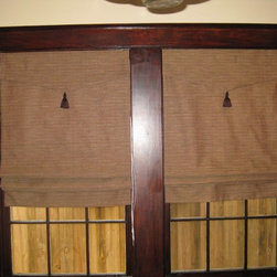 Roman Shades - Brown tweed roman shades w/triangle and tassel attached valances and blackout lining