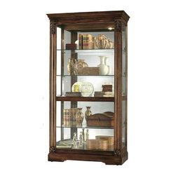 Howard Miller - Andrews Transitional Side Entry Curio Cabinet - Regal and refined, the Andrews Traditional curio comes in a rich Tuscany Cherry finish detailed with acanthus leaf carvings over contoured columns. Its beveled glass door slides in either direction for ease of access to your displays. * This display cabinet is finished in Tuscany Cherry on select hardwoods and veneersThe front door slides in both directions for easy access to the shelves and features acanthus leaf column caps over a contoured columnBeveled glass on the front door for added elegancePad-LockTM metal shelf clipsAmple display space with four glass shelves for five levels of displayPlate grooves allow vertical display of plates for best viewingGlass mirrored back enhances the displayFront locking door for added securityAn adjustable light switch features halogen light and offers four levels of lighting intensity: low, medium, high, and offAdjustable glass shelves--Continuous holes for maximum shelf adjustmentHeight-adjustable feet under all four corners provide stability on uneven and carpeted floors78 in. H x 42 in. W x 14.25 in. D