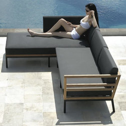 Zudu Outdoor Corner Sectional - The contemporary designed Zudu series from Mamagreen™ features a corner sofa and chaise, lounge chair, ottoman and coffee table made of recycled teak wood.