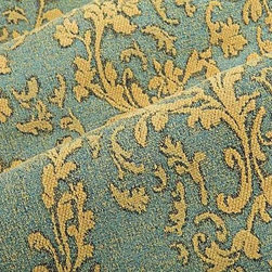 Relief Damask Upholstery Fabric in Sapphire - Relief in Sapphire is a blue damask upholstery fabric with an interesting relief texture created from chenille yarns. This hearty cotton blend is perfect for upholstering sofas, chair, and ottomans. The classic pattern works will with traditional designs. American made from a blend of 53% cotton, 31% polyester, and 16% rayon. Cleaning code: S. Repeat: 33 1/2″V 13 1/2″H; Width: 50″.