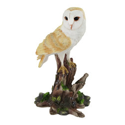 Barn Owl Vigilantly Perched on Tree Stump Statue - This vivid statue depicts a majestic owl perching on a colorfully adorned tree stump. The detail and hand painted color of the piece are incredibly intricate. The owl, with scrupulously designed tan feathers accented with small grey spots, seems alive and vigilantly searching for that scurrying field mouse. The gnarled dead tree stump, serving as the bird of prey's perch, has been brought back to life with nature's adornments of winding green vines and bristly patches of green lichens. This exquisite display of natural beauty, crafted from cold cast resin, measures 5 inches tall, 3 inches long, and 2 1/2 inches wide. Add this brilliant display as a colorful accent to your home or give it as a gift to a nature lover.