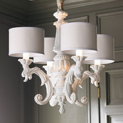 """White Baroque Chandelier - Shiny silver and crystals just not your taste?  This classic design finished all in white, may be just the lighting you need for your home.  This chandelier would work well in a traditionally designed room as well as cottage style decor.With a streamlined design and high-gloss, whiter-than-white finish, it's made of resin with petite parchment drum shades.27""""Dia. x 29""""T."""