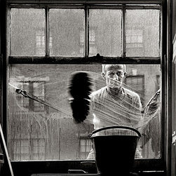 """Window Washer"" Artwork - The window washer was photographed in the mid 1950's and is part of the ""window people"" series which was featured on the today show. the image was taken in my studio on east 68th street in nyc. i was fascinated by the indifferent expression on his face and also by the pattern that his brush was making. this was not a set-up shot. it occurred naturally and it illustrates again the importance of being ready, recognizing and capturing that ""moment in time"". the image is printed on 13""x19"" fine art baryta. live image area is 9.9""h x 9.5"" w."