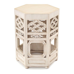 Travers Accent Table in Glazed White - Cloudless days passed in a summer house by the sea, where dreams drift among white sails, blue wavelets, and velvet sands. With its airy design and soft glazed white finish, the Travers Accent Table in Glazed White takes its inspiration from abodes that grace the Mediterranean coast. The table's hexagonal shape and pierced carved decoration create a distinctive silhouette.