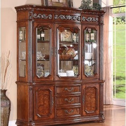 Cordoba China Cabinet - A study in classic English styling with distinct Mediterranean influences, the Cordoba China Cabinet is sure to make an impression in setting with reeded pilasters and carved crown moldings. The three felt-lined top drawers are specially designed for your silverware, while two adjustable shelves behind three doors keep trays, glassware, and napkins within arm's reach. Interior lighting and plate grooves in the hutch allow for aesthetic display of your favorite China. The marble top and beautiful, burnished pine finish highlights the cabinet's upscale charm, making it the right choice for any setting. Sturdy construction from select hardwoods and pine and ash veneers means this handsome China cabinet will be a part of your dining space for years to come.DimensionsBuffet: 69W x 20D x 32H inchesHutch: 69W x 19D x 52H inchesOverall (buffet & hutch): 69W x 20D x 84H inchesAbout Wynwood FurnitureAt Wynwood, designing unique and useful furniture is the goal. The company's own fashion consultants scour the globe for distinctive woods and eye-catching designs before bringing their findings back home to talented designers who set about creating beautiful pieces. The designs are then moved into production, where Wynwood specializes in ensuring all collections are both stunning and useful, giving every piece a thorough going-over that results in inimitable style, impeccable construction, and unequaled functionality.
