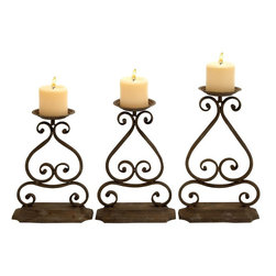 Benzara - Candle Hold with Elegant Design and Structure - Set of 3 - Create an indelible impression on your guests during parties with this magnificent set. This set of 3 metal candle holders are marked by their simple yet extremely aesthetic design and structure. These metal candle holders enhance the beauty of your dinner table and add elegance to the entire ambience remarkably well. Each of these pieces has a sturdy base that makes it better balanced. The candle base is wide enough to hold big candles too. The neat and uncluttered art work done in wrought metal is the USP of this set which adds a touch of elegance and beauty to it. The dark brown color given to this set compliments all types of decor. Use these pieces together or separately, they still create a stunning effect along with the soft and warm glow of the candles. You can use them as decorative pieces on table tops, consoles or the mantelpiece.