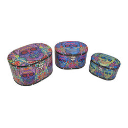 Set Of 3 Day of the Dead Sugar Skull Themed Oval Shaped Boxes - These oval boxes provide a little extra storage space and add a fun accent to your home. They are perfect for storing small keepsakes, craft and hobby supplies, and collections of small items in an attractive way, so you don`t have to hide the boxes in a closet. The boxes are made of wood and covered with a canvas material that features colorful Day of the Dead sugar skull graphics. The lids are hinged and have clasps to secure them. The largest box measures 14 inches long, 10 1/2 inches wide, 8 inches tall, the middle one is 12 inches long, 9 inches wide, 6 3/4 inches tall, and the smallest measures 10 inches long, 7 inches wide, 5 1/2 inches tall. They nest for storage purposes, and look great stacked in the corner of a room or on a table or shelf.
