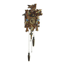 Schneider Cuckoo Clocks - Quartz Cuckoo Clock w Hand Painted Flowers - Carved style. 1-day rack strike movement. Cuckoo calls and strikes every half and full hour. Minimum moving hand. Twelve different melodies. Carving with painted flowers. Wooden cuckoo, dial with roman numerals and hand. Two plastic weights. Clock with reliable quartz movement, carving, clock case, bird, dial and hand carved wood. Shut-off lever on left side of case, silences the strike, call and music. Full automatic night shut-off at 9 pm to 6 am. Manual shut-off switch on left side of clock. Push button to set strike and time into sequence on left side of clock. Made from wood. Made in Germany. 8.07 in. W x 6.10 in. D x 12.20 in. H (4.41 lbs.). Care Instructions