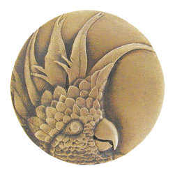 "Notting Hill - Notting Hill Cockatoo (Small - Left side) Knob - Antique Brass - Notting Hill Decorative Hardware creates distinctive, high-end decorative cabinet hardware. Our cabinet knobs and handles are hand-cast of solid fine pewter and bronze with a variety of finishes. Notting Hill's decorative kitchen hardware features classic designs with exceptional detail and craftsmanship. Our collections offer decorative knobs, pulls, bin pulls, hinge plates, cabinet backplates, and appliance pulls. Dimensions: 2"" diameter"