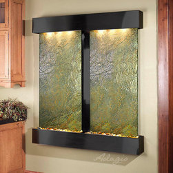 Slate Wall Mounted Water Features - The Cottonwood Falls with Green Slate - The Cottonwood Falls Wall Fountain with Slate Face is breath-taking with its dual panels of beautiful Slate. With two selections of Slate to choose from, there are several colors, styles, and looks you can achieve by simply selecting a different stone. This large water wall ships directly to your door, for free anywhere in the continental US. Installation is simple and each fountain arrives with a full installation DVD and set-up manual. The Cottonwood Falls with Slate face is perfect for anyone looking to add some serious style to their interior space. Available with round or square corners and rainforest green, rainforest brown or black spider Slate... and three finishes: Rustic Copper, Stainless Steel, or Antiqued Blackened Copper Finish.