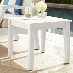 """Hampstead Side Table, White - Lounging outdoors on a sunny day is especially relaxing with durable, well-built furniture on hand. Our side table is expertly crafted from FSC-certified mahogany and features classic details such as a slatted top and gently splayed legs. Click to read an article on {{link path='pages/popups/hampstead-white-care.html' class='popup' width='640' height='700'}}recommended care{{/link}}. 21.5"""" square, 18.5"""" high Crafted of solid mahogany and sealed for moisture resistance. Exposed hardware has a silver finish. View our {{link path='pages/popups/fb-outdoor.html' class='popup' width='480' height='300'}}Furniture Brochure{{/link}}."""