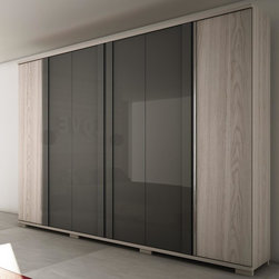 Manhattan Comfort - Manhattan Soho Wardrobe In Nature White and Onyx - The Soho is a large  functional wardrobe with handles that extend the entire length of the doors  providing a modern look. Its color combination was chosen to create a cozy atmosphere using light wooden tones. A combination of Oak Vanilla and Metallic Nude creates a sophisticated ensemble that will add to any room. Its many shelves  drawers  and aluminum rods allow you to neatly fold or hang items to keep things organized  and out of sight. The Soho features a Pro-Touch High definition  ultra-resistant finish with the texture of natural wood  and stylish wood patterns. The unique paint is protected by the Microban Antibacterial Protection.