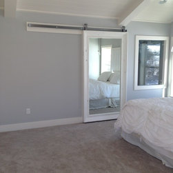 """D.S. Custom Project - A single barn door from the master into the bathroom made with Massiv's 6"""" Silverton profile in Dove White. 71"""" x 33"""" int dim 83"""" x 45"""" ext dim"""