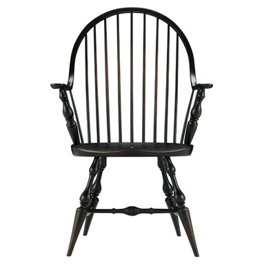 "Buckingham Windsor Arm Chair - A classic dining chair made the classic way. In bringing a Windsor style chair to Arhaus, we wanted to recreate the elements that mark the style—hoop back, large scooped seat and turned legs—and make it the benchmade way. That meant taking our Buckingham Windsor Chair to our Amish artisan friends, who are known for their superb woodworking skills and techniques like traditional ""through holed and wedge"" spindle and leg construction. A Windsor chair is a natural fit for Arhaus dining tables, exuding the warmth and craftsmanship of our dining collections."
