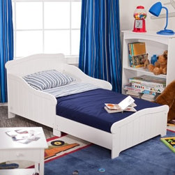 "KidKraft Nantucket Toddler Bed - Straight from the shores of the East Coast this classic bed looks like it came from a summer beach house. Traditionally styled with a paneled headboard footboard and security sides with smooth white lines the KidKraft Nantucket Toddler Bed is the small child's version of the classic American original. It's constructed from strong and durable rubberwood and painted in white with lead-free non-toxic paint. Recommended age is 15 months and older not to exceed a weight capacity of 50 pounds. A regular crib mattress can be used with this charming bed (mattress not included).The beauty and benefits of rubberwood: Hailing from the maple family of trees and originally native to Thailand the rubber tree is used in the manufacture of high-end furniture. It is valued for its dense grain minimal shrinkage attractive color and acceptance of different finishes. It is also prized as an """"environmentally friendly"""" wood as it makes use of trees that have been cut down at the end of their latex-producing cycle.About KidKraftKidKraft is a leading creator manufacturer and distributor of children's furniture toy gift and room accessory items. KidKraft's headquarters in Dallas Texas serve as the nerve center for the company's design operations and distribution networks. With the company mission emphasizing quality design dependability and competitive pricing KidKraft has consistently experienced double-digit growth. It is a name parents can trust for high-quality safe innovative children's toys and furniture."