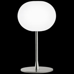 Flos Lighting - Glo-Ball T1 Table Lamp by Flos Lighting - The Flos Glo-Ball T1 Table Lamp puts the Glo-Ball up on a pedestal (in this case, a thick steel base and stem). The sturdy base provides a stable foundation for the hand-blown, acid-etched Opaline glass sphere. Also available as the larger Glo-Ball T2 Table Lamp. Part of the Flos Glo-Ball collection, designed by Jasper Morrison.Flos was first established in 1962 in Merano, Italy, to produce high quality modern lighting. This Italian lighting company continues to do so to this day by collaborating with talented international designers and researching the latest lighting technologies and materials. Resulting Flos lighting fixtures are daring and provocative, yet uphold the fundamental principles of good design.The Flos Glo-Ball T1 Table Lamp is available with the following:Details:Hand-blown, acid-etched, flashed Opaline glass shadeSteel baseSilver finish10' polarized power cordIn-line full range dimmerUL ListedMade in ItalyDesigned by Jasper Morrison, 1998Lighting:One 100 Watt 120 Volt T10 Halogen lamp (included).Shipping:This item usually ships within 3 to 5 business days.