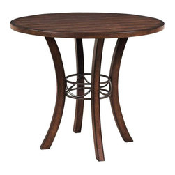 """Hillsdale Furniture - Hillsdale Cameron Round Wood Counter Height Table in Chestnut Brown - Hillsdale's Cameron collection beautifully combines a warm Chestnut Brown wood finish with a dark grey metal and offers a multitude of choices to create the perfect Counter height dining group for your home.  Starting with the non-swivel stools  you have the choice of three lovely designs:  The X-back stool combines a warm Chestnut Brown top accent with a transitional metal X in the center of the back and a brown faux leather seat.    The parson's stool is traditional in design and combines the warm Chestnut brown finish with the brown faux leather seat.  The ladder back stool features 3 rungs in the Chestnut brown finish  enhanced by the dark grey metal and brown faux leather seat.  Now that you've decided on your stool  let's look at the table options:  The stunning rectangle table features a wood top that is generously scaled to easily accommodate 6.   The round wood table is 42"""" in diameter and features a wonderful metal accent on the base."""