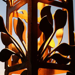 Attraction Lights overview - Leaf Cluster Spire detail (9x9x100 inch), natural rust finish, 3/16 inch steel.  Photo by Lyle Braund