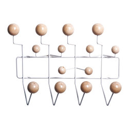 Hang-It-All Coat Rack - Add a pop of wall art to your front hall, foyer, or any room in your house or office. Made of white metal and wood balls, this hanging rack holds jackets, scarves, skates, knapsacks, jump rope, etc. More than just a conversation piece, the Hang-It-All holds anything that slips over its wooden hooks.